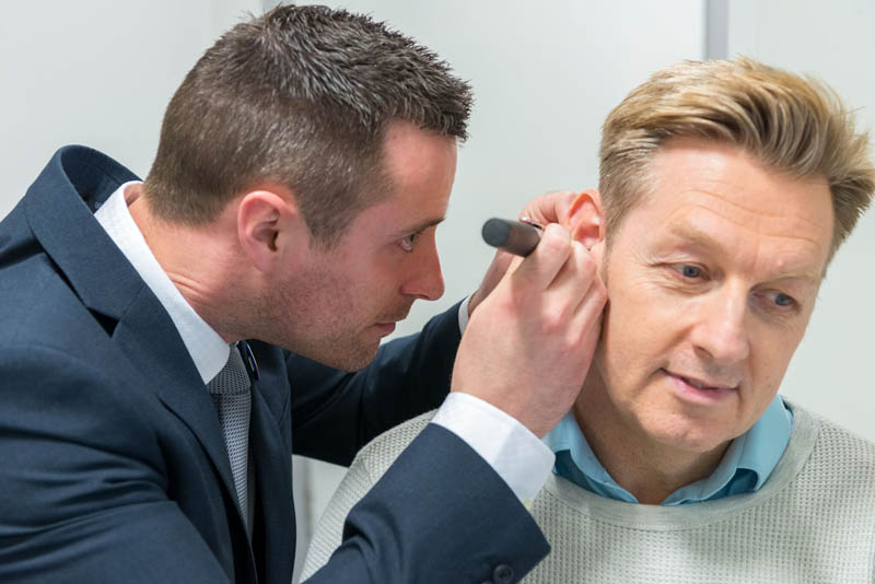 audiologist checking hearing