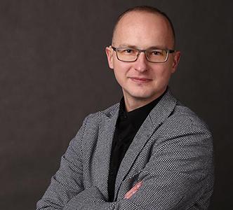 Rafał Wysogląd - poznaj historię niedosłyszącego informatyka